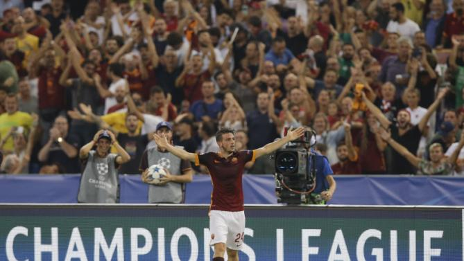 Roma's Alessandro Florenzi, right, celebrates after scoring during the Champions League Group E soccer match between Roma and Barcelona in Rome's Olympic stadium, Italy, Wednesday, Sept. 16, 2015.